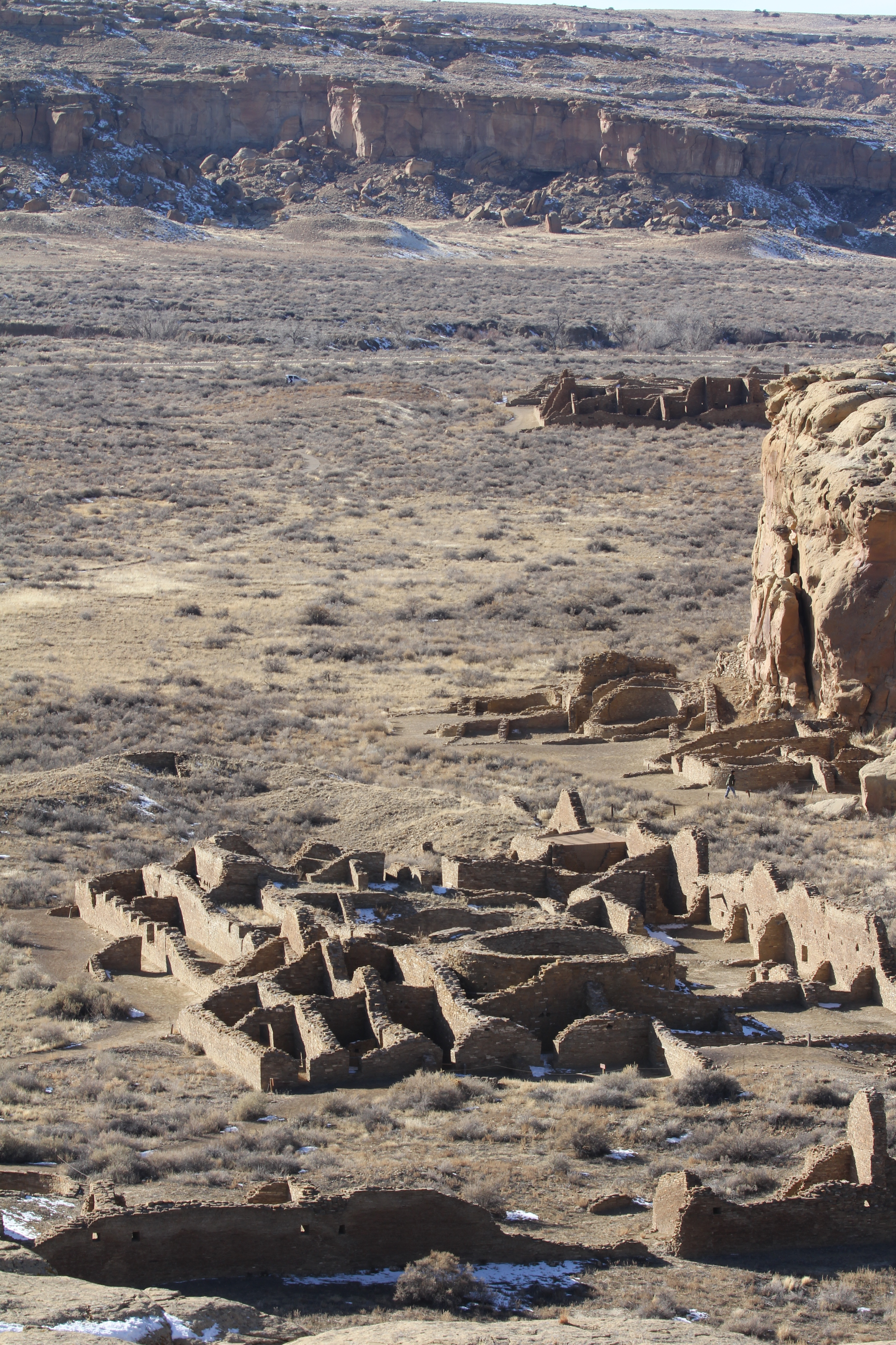 Chetro Ketl ruins with Pueblo Bonito in the background at Chaco Canyon in Nageezi, NM